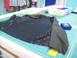 Adding the sequinned fabric to the back.