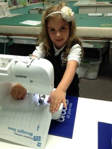 My youngest student has just turned six! She is learning to sew safely on paper!